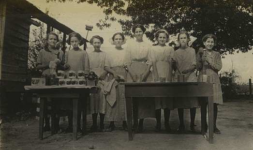 """Tomato"" Girls Club group displaying fresh and canned tomatoes, 1912; Mabelvale Home Demonstration Club Records MC1640 © Pryor Center for Arkansas Oral and Visual History, University of Arkansas"