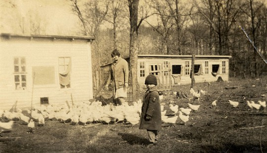 Woman and child tending the chickens, ca. 1929, from the Kilkare Home Demonstration scrapbook; Blanche Hanks Elliott Papers MC1272 © Pryor Center for Arkansas Oral and Visual History, University of Arkansas