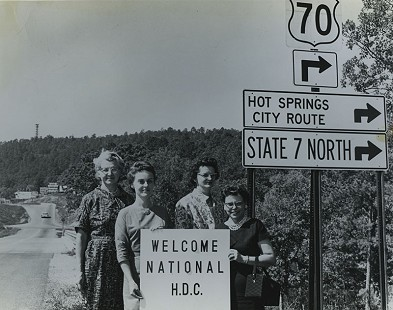 On the way to the National H.D.C. meeting, Mrs. Paul Rukavina, Lake Hamilton HDC, Mrs. James E. Winston, Gardner HDC, Mrs. James A. Worthy, Pleasant Hill HDC, Mrs. Don Wayman, Daniel HDC, 1963-64; Garland County Extension Homemaker's Club Records MC1117 © Pryor Center for Arkansas Oral and Visual History, University of Arkansas