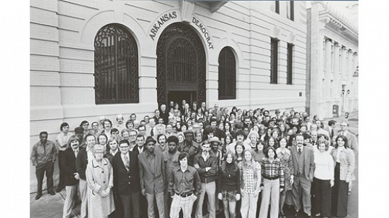 Arkansas Democrat employees pose in the mid-1970s.  The man on the far right is publisher Walter Hussman Jr. © Photograph courtesy of Jerry McConnell