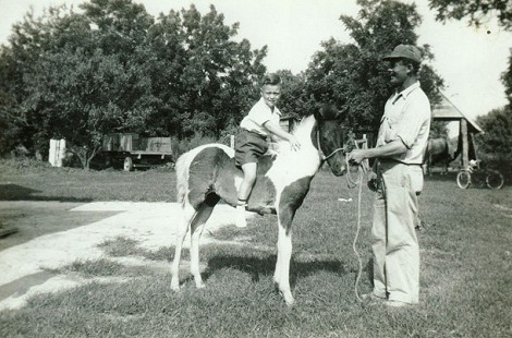 Mike Beebe riding a pony with his uncle, Toy Huskey; north of Tuckerman, Arkansas © Pryor Center for Arkansas Oral and Visual History, University of Arkansas