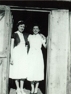 Mike Beebe's aunt, Dane Huskey Giles, with his mother, Maedean Beebe, standing in the doorway of a structure that used to be a railroad house for travelers; Amagon, Arkansas © Pryor Center for Arkansas Oral and Visual History, University of Arkansas
