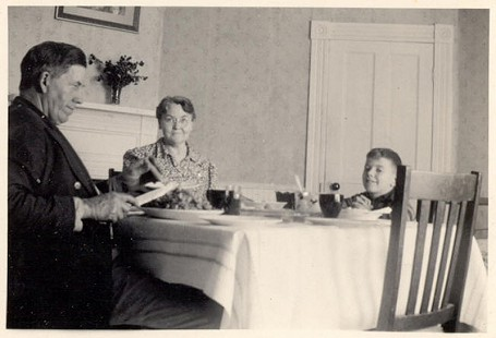 Jim Blair at the dinner table with his grandparents, Rufus and Bessie Blair © Pryor Center for Arkansas Oral and Visual History, University of Arkansas