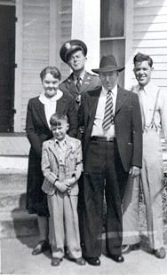 Jim Blair with his family: grandmother, Bessie; father, Joe; grandfather, Rufus; and uncle, Hugh Blair © Pryor Center for Arkansas Oral and Visual History, University of Arkansas