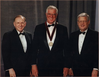 Towers of Old Main Induction 2001; Chancellor John White, Jim Blair, and B. Alan Sugg  © Pryor Center for Arkansas Oral and Visual History, University of Arkansas