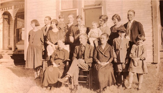Left to right, top row: Bess, Harmon, Ola, Margaret, and Babe Flanagan; Glen Bumpers; Callans Flanagan; Bernice and Floy Bumpers; Catherine and Jack Root; bottom row: Grandma Flanagan, Papa and Mama Flanagan, Warren and Genevieve Flanagan © Pryor Center for Arkansas Oral and Visual History, University of Arkansas