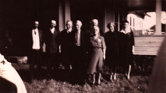 Betty Flanagan Bumpers's grandparents, Thomas Lee and Elizabeth Flanagan, with their six children: Warren, Rex, Herman Edward, Norman, Floy, and Katherine Flanagan, in front of their home in Grand Prairie, Arkansas © Pryor Center for Arkansas Oral and Visual History, University of Arkansas