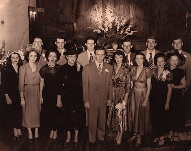 Dale and Betty Bumpers's wedding party: (back row, left to right) Sigler Carey, Miller Huggens, Carroll Bumpers, Callans Flanagan; Archie Schaffer, Louis Gramlick (front row, left to right) Ruth Flanagan Gramlich Wolfe, Bernice Bumpers Carey Stevens, Bequita Bumpers Huggins Gray, Ola Callan Flanagan, Dale and Betty Bumpers, Margaret Flanagan Schaffer, Margaret Bumpers Ware Kahliff, and Janice McGhee Flanagan; First Methodist Church of Charleston, Arkansas; September 14, 1949 © Pryor Center for Arkansas Oral and Visual History, University of Arkansas