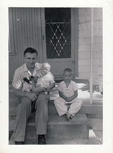 Dale Bumpers with his sons, Bill and Brent, on the porch steps of their first home, Charleston, Arkansas © Pryor Center for Arkansas Oral and Visual History, University of Arkansas
