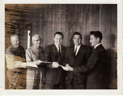 Dale Bumpers (center) with members of the Charleston Chamber of Commerce: (left to right) Howard Orsburn, Clyde Hiatt, Oliver Coonrod, and Paul F. Whittington; ca. early 1960s © Pryor Center for Arkansas Oral and Visual History, University of Arkansas