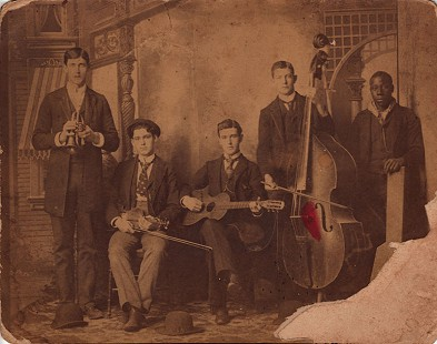 "Ed Burks's grandfather, Jay ""Pink"" Burks (holding violin), with band members, Monticello, Arkansas; March 15, 1891 © Pryor Center for Arkansas Oral and Visual History, University of Arkansas"
