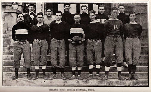 Ed Burks's father, Edwin Burks (holding football), with the Helena High School football team © Pryor Center for Arkansas Oral and Visual History, University of Arkansas