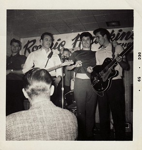 "Ed Burks (back to camera) with (from left) Jimmy Evans (bass), Fred Carter (guitar), Levon Helm (drums), Ronnie Hawkins, and Jimmy Ray ""Luke"" Paulman (guitar); Brass Rail, London, Ontario, Canada © Pryor Center for Arkansas Oral and Visual History, University of Arkansas"