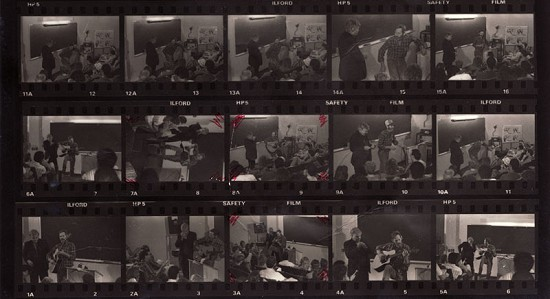 Print of negative strips of Ed Burks with Levon Helm performing in a classroom © Pryor Center for Arkansas Oral and Visual History, University of Arkansas