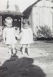 Terry Cagle with his cousin, Treda Reed; Turkey Scratch, Arkansas, ca. 1950s © Pryor Center for Arkansas Oral and Visual History, University of Arkansas