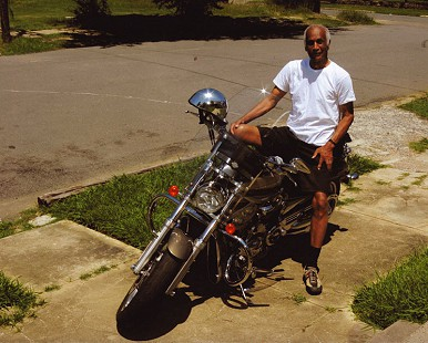 Milton P. Crenchaw on his motorcycle © Pryor Center for Arkansas Oral and Visual History, University of Arkansas