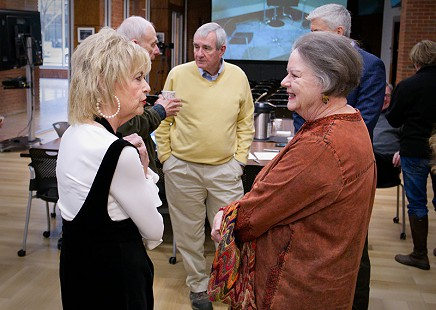 Martha Jr. Conley speaking to Barbara Pryor with (from left) David Pryor, Dan Ferritor, and Pate Felts in the background; Pryor Center, Fayetteville, Arkansas, 2018 © Pryor Center for Arkansas Oral and Visual History, University of Arkansas