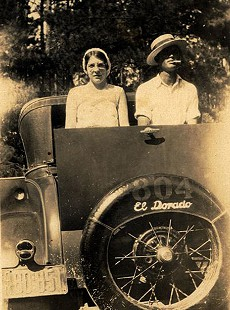 Lovie Armer Brown and Joseph Clifton Dumas, father of Ernie Dumas, in rumble seat © Pryor Center for Arkansas Oral and Visual History, University of Arkansas