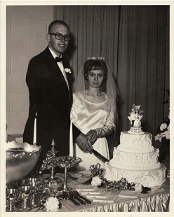 Ernie and Elaine Dumas cutting their wedding cake, June 1964 © Pryor Center for Arkansas Oral and Visual History, University of Arkansas
