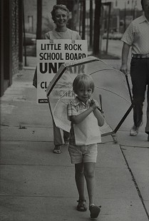Elaine Dumas, wife of Ernie Dumas, with son, Christopher, picketing outside the Little Rock School Board offices, ca. 1975 © Pryor Center for Arkansas Oral and Visual History, University of Arkansas