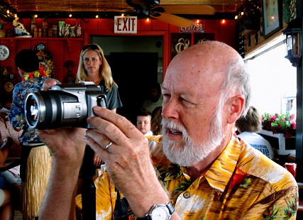 Ernie Dumas taking photos in Maui, Hawaii © Pryor Center for Arkansas Oral and Visual History, University of Arkansas