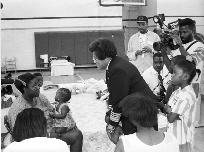 Joycelyn Elders speaking to a mother with her baby © Pryor Center for Arkansas Oral and Visual History, University of Arkansas