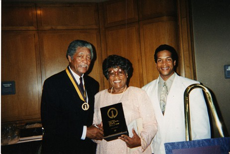 Joycelyn Elders with her son and husband holding the National High School Sports Hall of Fame award © Pryor Center for Arkansas Oral and Visual History, University of Arkansas