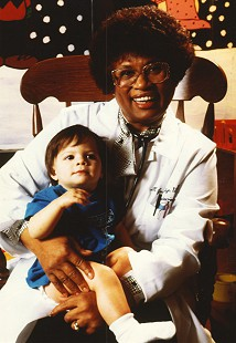 Joycelyn Elders with a patient at Arkansas Children's Hospital, 1995 © Pryor Center for Arkansas Oral and Visual History, University of Arkansas