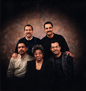 Lizzie Ferguson and her sons: (back row) Robert, Randall Jr.; (front row) James, Lizzie, John, December 1995 © Pryor Center for Arkansas Oral and Visual History, University of Arkansas