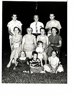 Edmond Freeman (top right) and June Freeman (seated 2nd from right) at Freeman family picnic, 1956 © Pryor Center for Arkansas Oral and Visual History, University of Arkansas