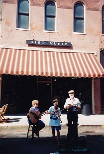 Eulaine and Hank Blumenthal and their grandson, Kevin Lowe, in front of Gist Music Company during the King Biscuit Blues Festival; Helena, Arkansas, 1997 © Pryor Center for Arkansas Oral and Visual History, University of Arkansas