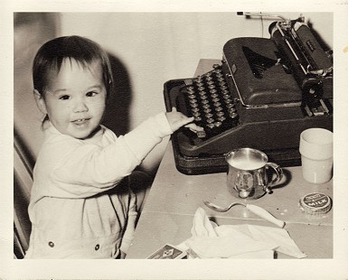 Hank Haines's daughter, Elizabeth Haines, at typewriter, ca. 1953 © Pryor Center for Arkansas Oral and Visual History, University of Arkansas