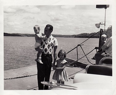 Hank Haines with his daughters, Harriett and Elizabeth (standing); Norfork Lake Ferry, ca. 1956 © Pryor Center for Arkansas Oral and Visual History, University of Arkansas