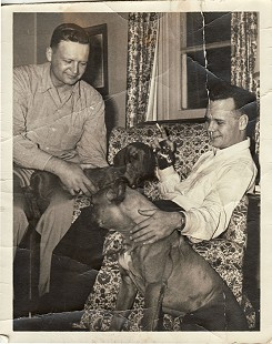 Hank Haines (right) with Ross Dillon Hughes and dogs © Pryor Center for Arkansas Oral and Visual History, University of Arkansas