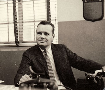 Hank Haines at his desk in the <i> Courier News</i> office © Pryor Center for Arkansas Oral and Visual History, University of Arkansas