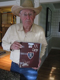 "Earl Hale holding his copy of <i>Saga of the XX ""Ghost"" Corps: Its History and Service in World War II</i> © Pryor Center for Arkansas Oral and Visual History, University of Arkansas"