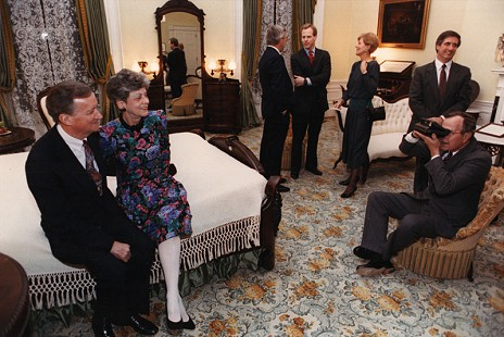 George H. W. Bush taking a picture of VIrginia and John Paul Hammerschmidt in the Lincoln Bedroom at the White House;  January 25, 1989                               © Pryor Center for Arkansas Oral and Visual History, University of Arkansas