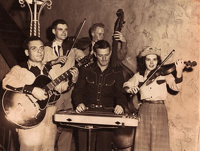 Ronnie Hawkins's cousins, Marvin Haskins (far left) and Dorlas Haskins (far right); Montana © Pryor Center for Arkansas Oral and Visual History, University of Arkansas