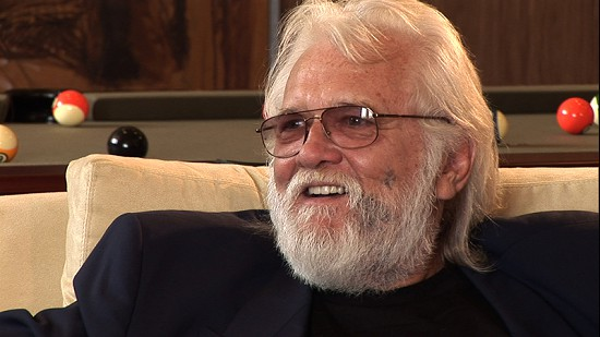 Still frame from Pryor Center video interview with Ronnie Hawkins at the Blessings Golf Club; Fayetteville, Arkansas, 2005 © Pryor Center for Arkansas Oral and Visual History, University of Arkansas