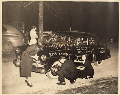 Friends decorating J. B. and Johnelle Hunt's getaway car before their wedding © Pryor Center for Arkansas Oral and Visual History, University of Arkansas