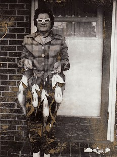 Johnelle Hunt's mother, Ollie DeBusk, on the front porch holding a stringer of fish, Heber Springs, Arkansas © Pryor Center for Arkansas Oral and Visual History, University of Arkansas