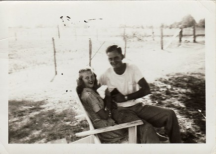 Johnelle DeBusk (Hunt) and J. B. Hunt sitting in an Adirondack chair © Pryor Center for Arkansas Oral and Visual History, University of Arkansas