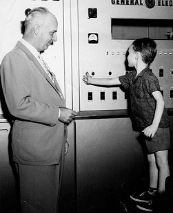 Walter E. Hussman Sr. (left) and Walter E. Hussman Jr. (right) pushing the button to turn on KCMC-TV; Texarkana, Arkansas, 1953 © Pryor Center for Arkansas Oral and Visual History, University of Arkansas