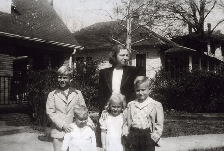 Chester Johnson standing in front of his brother, John Maxie Johnson, with their aunt, Kathleen Johnson, and cousins, Paula and Sam Paul Johnson; Monticello, Arkansas  © Pryor Center for Arkansas Oral and Visual History, University of Arkansas