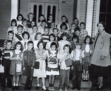 Chester Johnson (2nd row from top, 2nd from right) with his second-grade class and teacher, Ms. Edna Carmichel; Easter, 1952 © Pryor Center for Arkansas Oral and Visual History, University of Arkansas