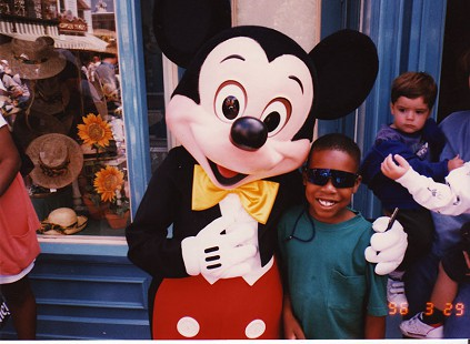 Bradley Jones, son of Bobby Jones, with Mickey Mouse © Pryor Center for Arkansas Oral and Visual History, University of Arkansas