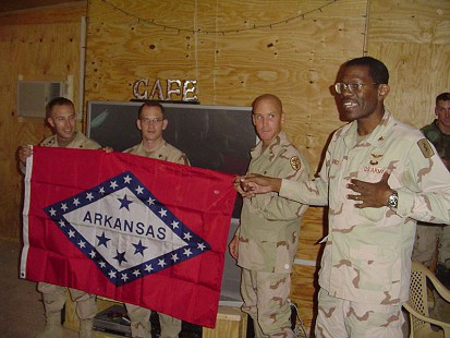 Dr. Bobby Jones at the military center with the Arkansas flag © Pryor Center for Arkansas Oral and Visual History, University of Arkansas