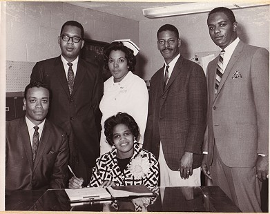 Edith Irby Jones signing papers at Mercy Hospital  © Pryor Center for Arkansas Oral and Visual History, University of Arkansas