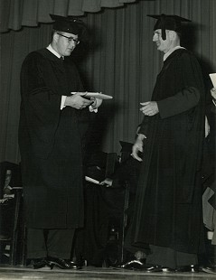 Bob Lamb (left) receiving his diploma at Arkansas State Teachers College, 1954 © Pryor Center for Arkansas Oral and Visual History, University of Arkansas