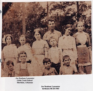 Bill Lancaster's father, Joe Donham Lancaster (front row, 2nd from right), with classmates of Little Creek School, Sheridan, Arkansas © Pryor Center for Arkansas Oral and Visual History, University of Arkansas